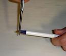Using pliers to take apart a Bic pen